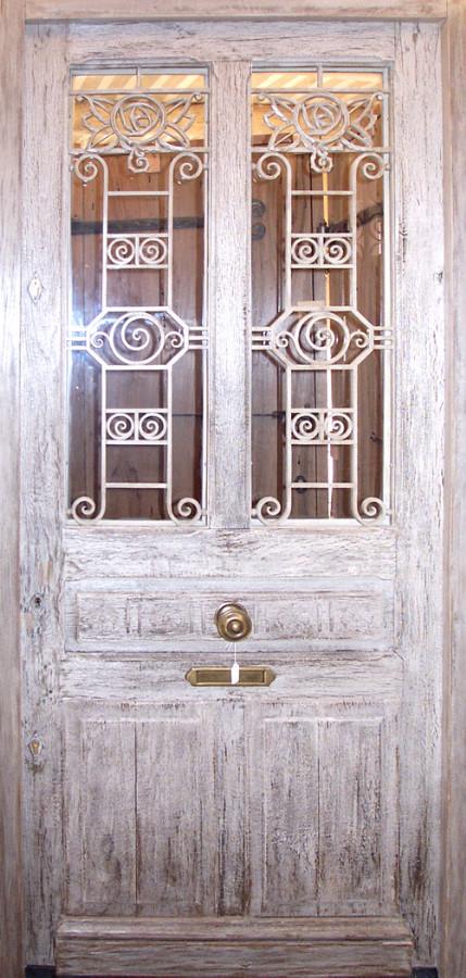 Oak front door with wrought iron grills Front doors . Portes Antiques